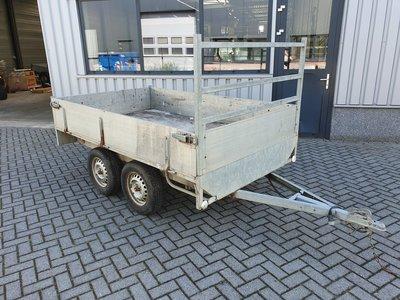 2e hands ongeremde dubbelas plateauwagen met nieuwe onderdelen.